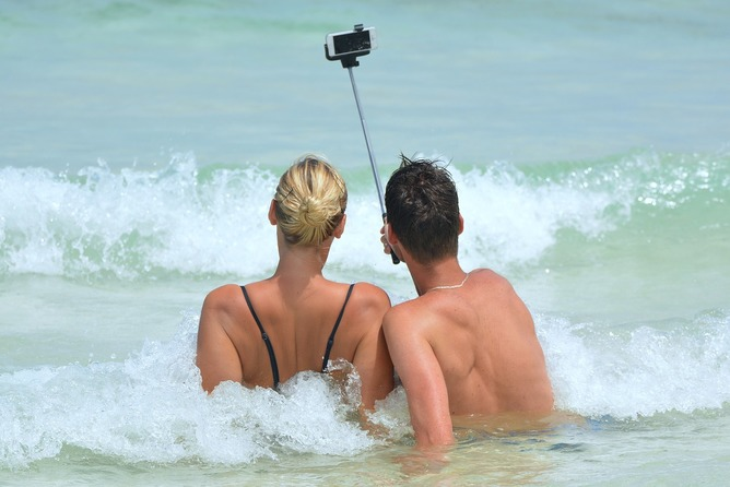 Couple taking a selfie while swimming in the ocean