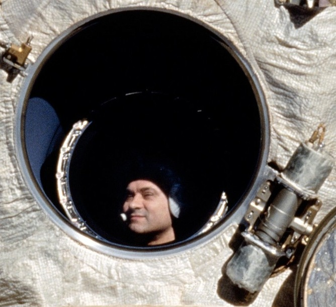 Cosmonaut Polyakov, who holds the record for longest time spent in space with 438 days, looks out Mir's window. Source: NASA