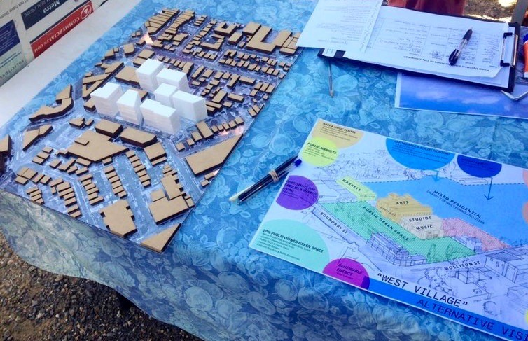 An alternative plan (right) is presented alongside the developer's model (left) at the community picnic. Author provided