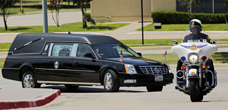 Hearse carrying the body of Dallas police officer Sgt. Michael Smith via REUTERS. REUTERS/pool.