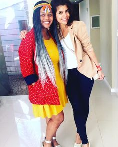 Presenter BusaBantu Dubazana and producer Leyla Tavernaro-Haidarian on set of the Soweto makeover show