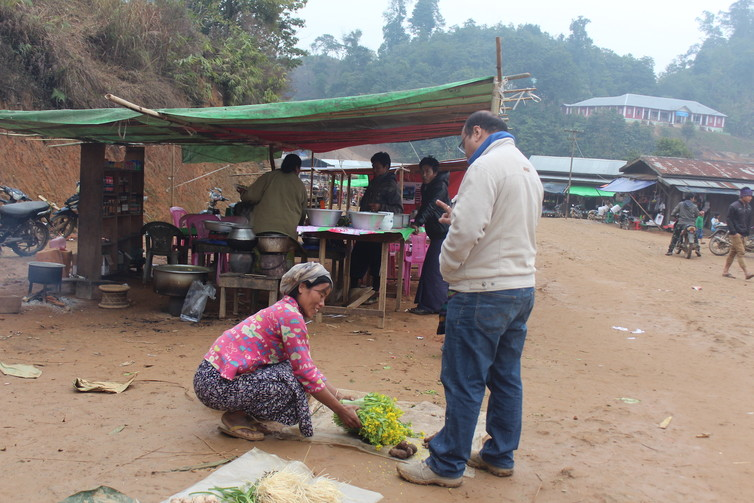 Indian tourists buy Burmese fern delicacies from the locals in the market on designated India Days, three times a month. Mirza Zulfiqur Rahman, Author provided
