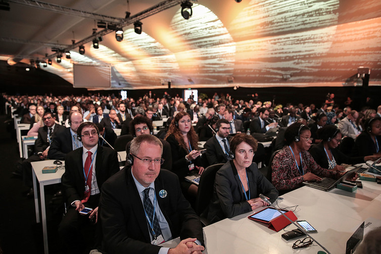 Participants and delegates attend the opening session of the Climate Conference in Marrakech, Morocco, on Nov. 7
