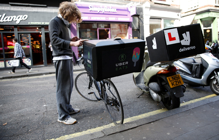 Uber is only just now starting to broaden its range of services to food delivery and is well behind what is offered by its rivals in emerging markets. (Reuters Photo/Neil Hall)