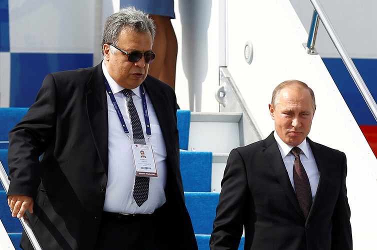 Karlov and Putin disembark from the presidential aircraft at Ataturk airport in Istanbul in October. Osman Orsal/Reuters