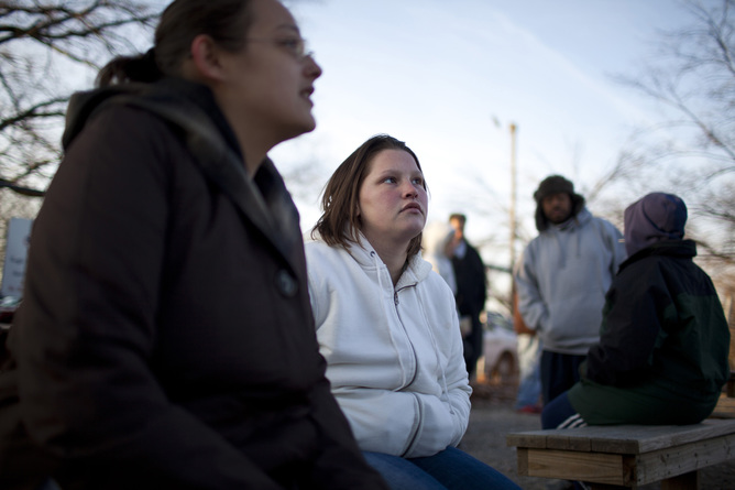 Planning for tomorrow is hard when you need to get through today. In this photo, Brandi Burnau and Jody Dildine wait outside the St Vincent de Paul food pantry in Indianapolis, Indiana, November 29 2012. Aaron P Bernstein/Reuters